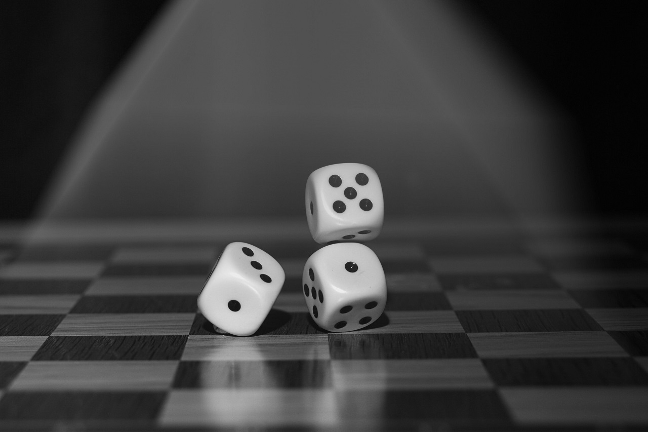 image of a pair of dice hanging on string